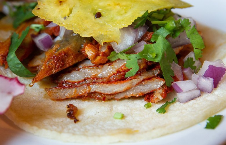 The al pastor tacos at Moderno Mexicano include pork shoulder roasted from a spit. (Andy Bao / The Seattle Times)