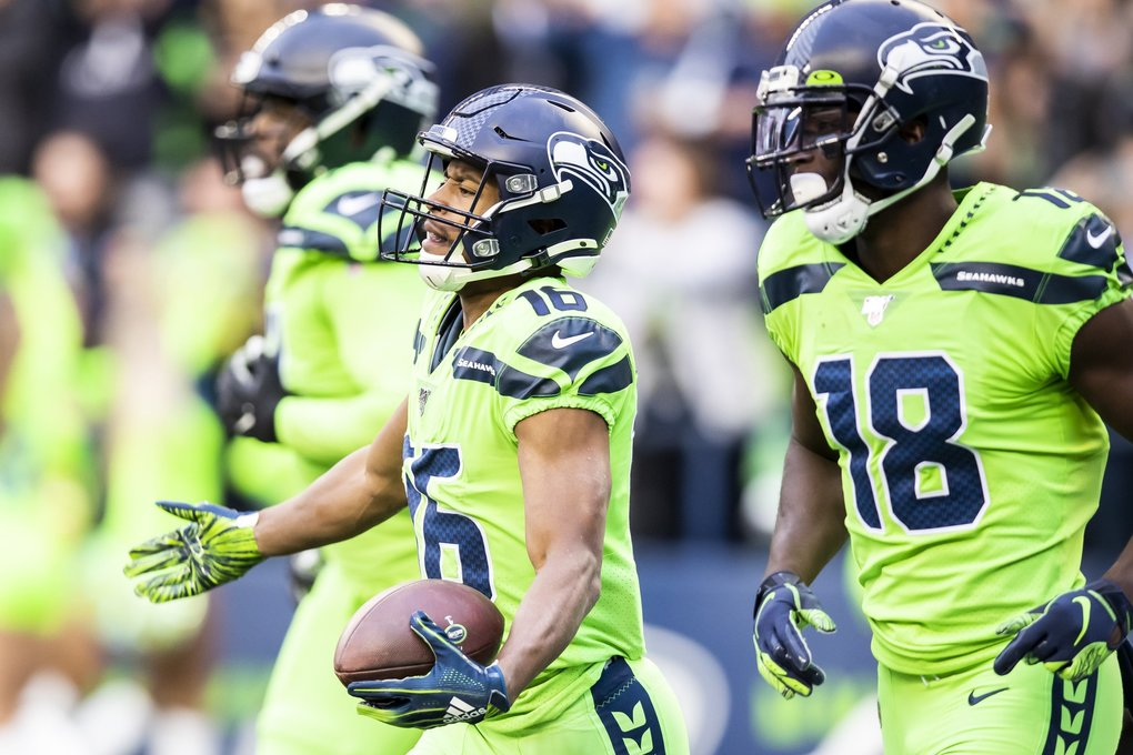 Seahawks wide receiver Tyler Lockett celebrates his 13-yard, toe-dragging touchdown in the first quarter as the Seattle Seahawks take on the Los Angeles Rams at CenturyLink Field in Seattle Thursday October 3, 2019.  (Mike Siegel / The Seattle Times)