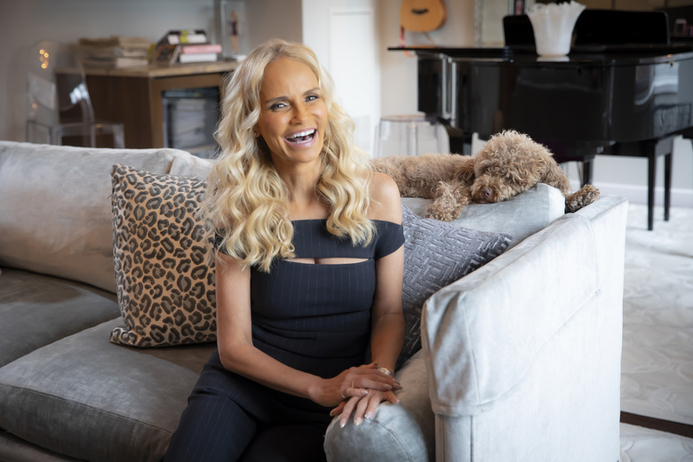 Kristin Chenoweth with her dog, Thunder, at her home in New York. Chenoweth's aesthetic is an evolving thing — the starting point was Ikea, and from there, she progressed to shabby chic, then to what she calls modern chic. (Tony Cenicola/The New York Times)