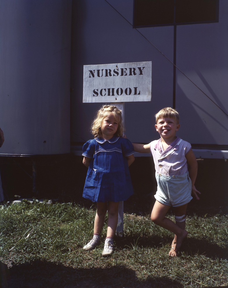 Children stand outside a government-run nursery school in Middle River, Maryland, circa 1941. It took a global war, and its production demands on the country's workforce, for the U.S. to make meaningful child care provisions for working parents. (National Archives via The New York Times)