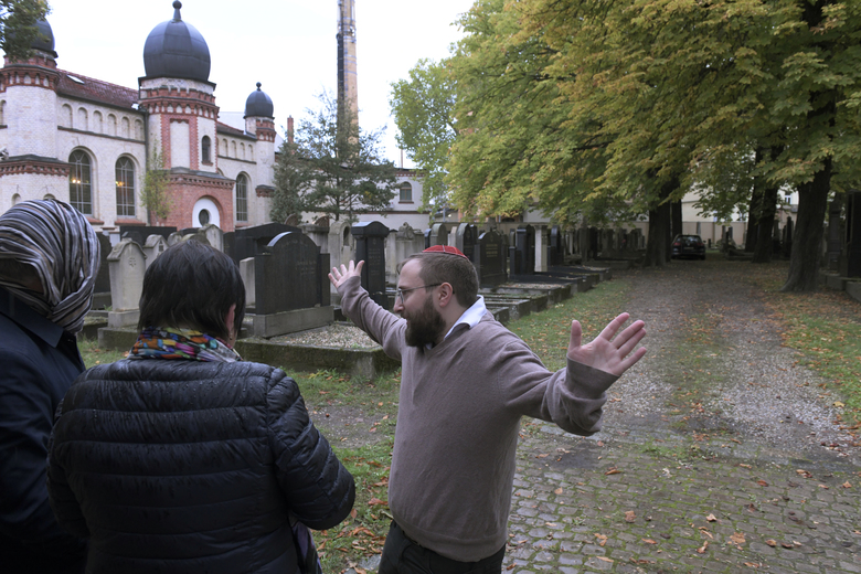 Jeremy Borovitz gestures as he stays in front of a synagogue in Halle, Germany, Thursday, Oct. 10, 2019. A heavily armed assailant ranting about Jews tried to force his way into a synagogue in Germany on Yom Kippur, Judaism's holiest day, then shot two people to death nearby in an attack Wednesday that was livestreamed on a popular gaming site. (AP Photo/Jens Meyer)