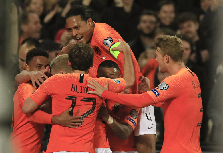 Netherlands' players celebrate their second goal during the Euro 2020 group C qualifying soccer match between The Netherlands and Northern Ireland at De Kuip stadium in Rotterdam, Netherlands, Thursday, Oct. 10, 2019. (AP Photo/Peter Dejong)