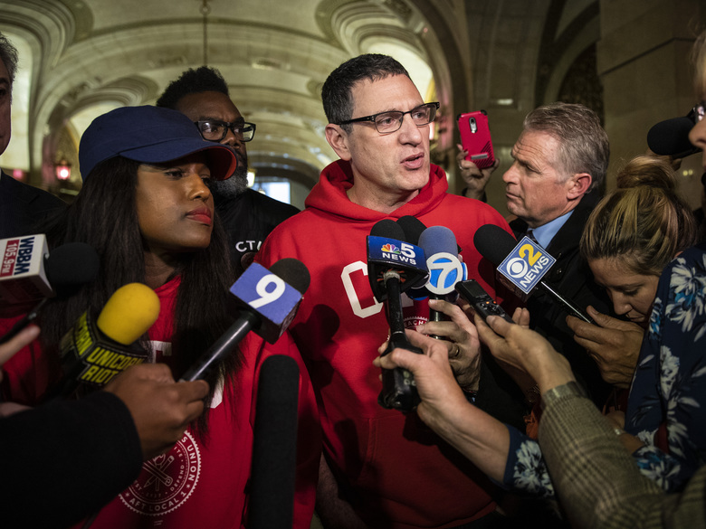Chicago Teachers Union Vice President Stacy Davis Gates looks on as President Jesse Sharkey speaks to reporters at City Hall about the end of the teachers strike, Thursday afternoon, Oct. 31, 2019. (Ashlee Rezin Garcia/Chicago Sun-Times via AP)