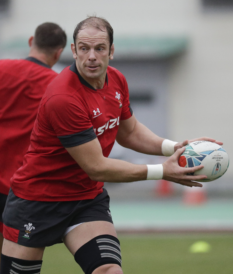 Wales rugby team captain Alun Wyn Jones prepares to pass the ball during training at Beppu, Japan, Wednesday Oct. 16, 2019. Wales will face France in the quarterfinals at the Rugby World Cup on Oct. 20. (AP Photo/Aaron Favila)