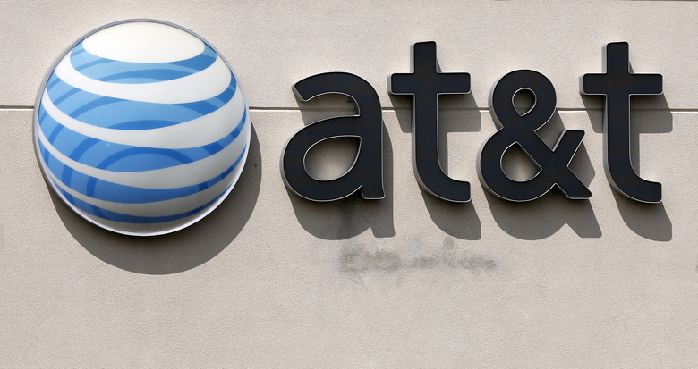 FILE – This May 14, 2014 file photo shows an AT&T logo on a store in Dedham, Mass. AT&T planned to announce details of its upcoming streaming service on Tuesday, Oct. 29, 2019. (AP Photo/Steven Senne, File)