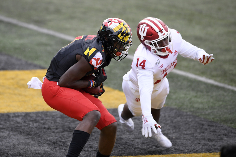 Maryland wide receiver Dontay Demus Jr. (7) scores a touchdown against Indiana defensive back Andre Brown Jr. (14) during the first half of an NCAA college football game, Saturday, Oct. 19, 2019, in College Park, Md. (AP Photo/Nick Wass)