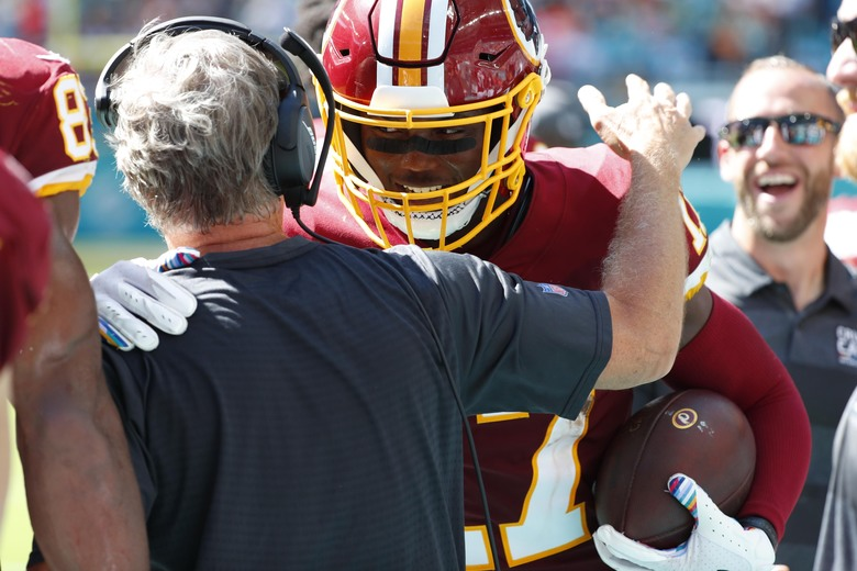 Washington Redskins interim head coach Bill Callahan congratulates wide receiver Terry McLaurin (17) after McLaurin scored his second touchdown of the game, during the second half at an NFL football game against the Miami Dolphins, Sunday, Oct. 13, 2019, in Miami Gardens, Fla. (AP Photo/Wilfredo Lee)
