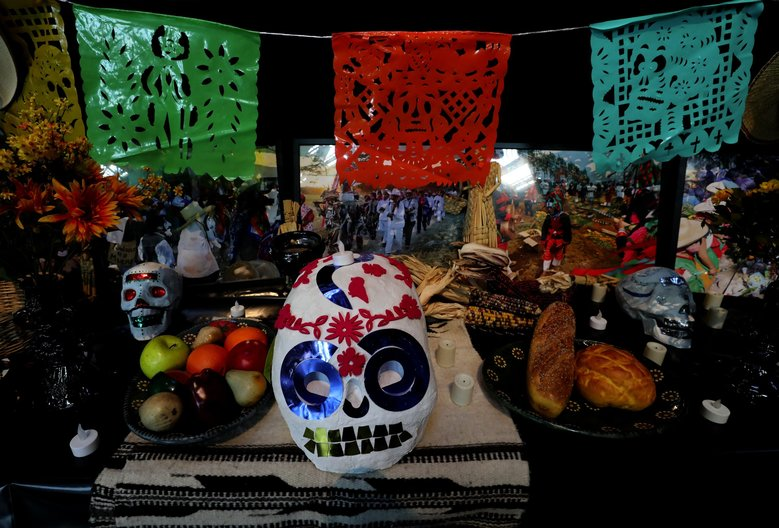 Offerings are made at an altar to honor the departed at Dia de Muertos at the Seattle Center Armory. The celebration continues Sunday from 11 a.m. until 6 p.m. (Alan Berner / The Seattle Times)