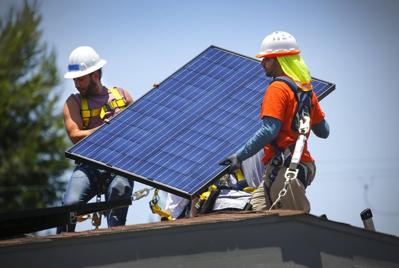 California leads the nation in rooftop solar installations. (Howard Lipin / TNS)