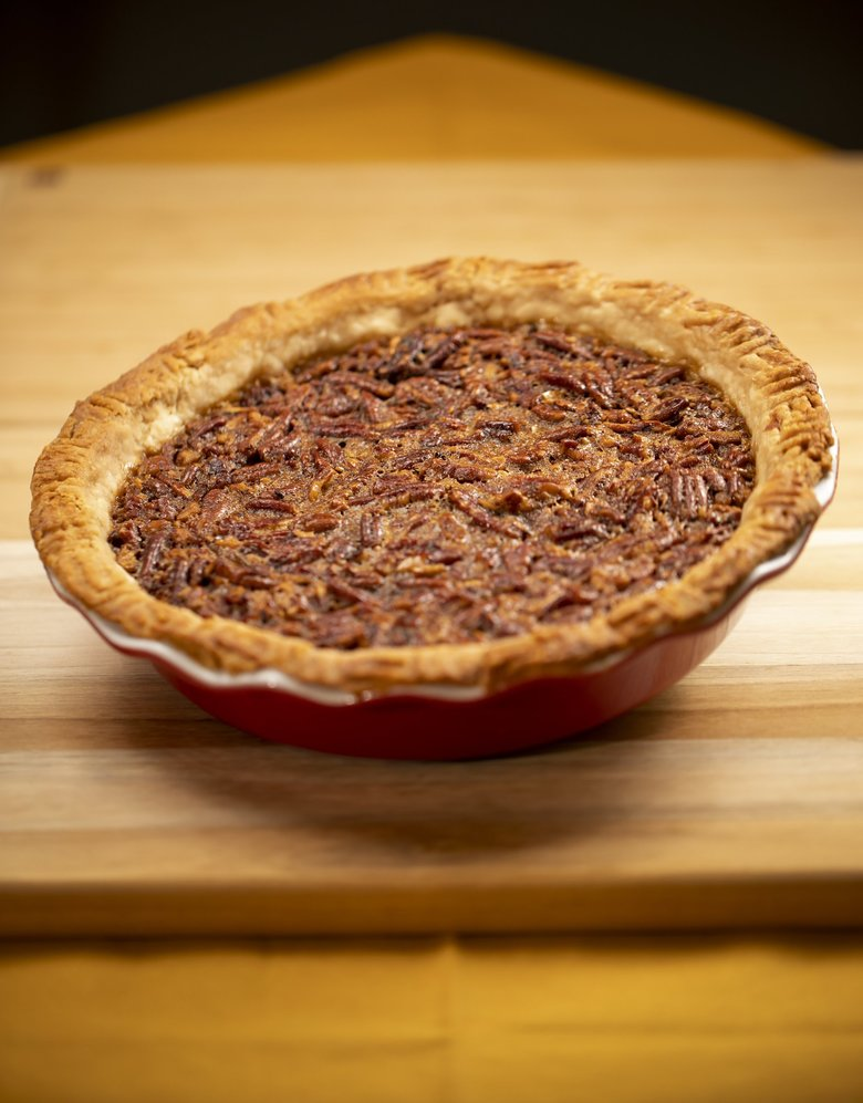 Jill Lightner can't eat the bourbon pecan pie she loves to bake because of her tree-nut allergy. But it was a favorite at holiday gatherings, especially for her father in his final years. (Bettina Hansen / The Seattle Times)