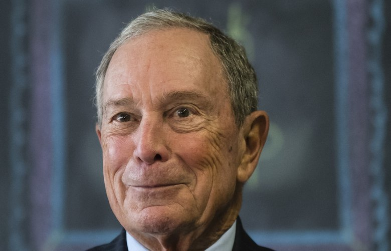 "FILE – In this Nov. 30, 2018 file photo, former New York Mayor Michael Bloomberg speaks with members of the media at The Bridge Way School in Philadelphia.   With Bloomberg now running for president, the news service that bears his name said Sunday, Nov. 24, 2019,  it will not ""investigate"" him or any of his Democratic rivals, and Bloomberg Opinion will no longer run unsigned editorials. (AP Photo/Matt Rourke) NYDK203 NYDK203"