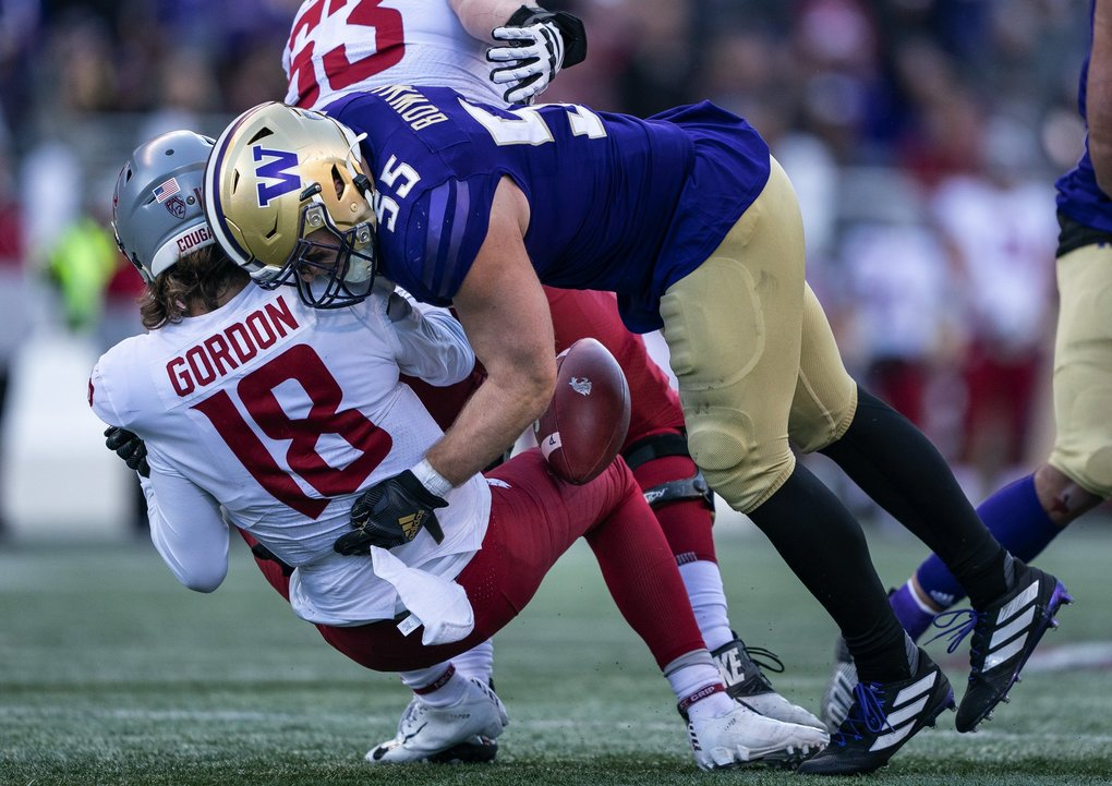 Washington's Ryan Bowman hits WSU Quarterback Anthony Gordon forcing him into a fumble in the second quarter that was recovered by the Cougars.  (Dean Rutz / The Seattle Times)
