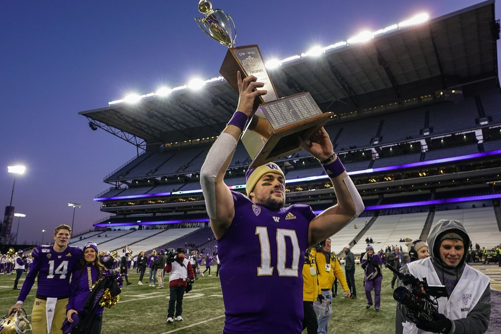 Jacob Eason walks off the Husky Stadium turf having won the Apple Cup with a 31-13 victory over Washington State. (Dean Rutz / The Seattle Times)