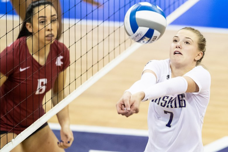 Huskies setter Ella May Powell (7) bumps the ball during the second set of the volleyball matchbetween University of Washington and Washington State at Alaska Airlines Arena on Saturday. (Andy Bao / The Seattle Times)