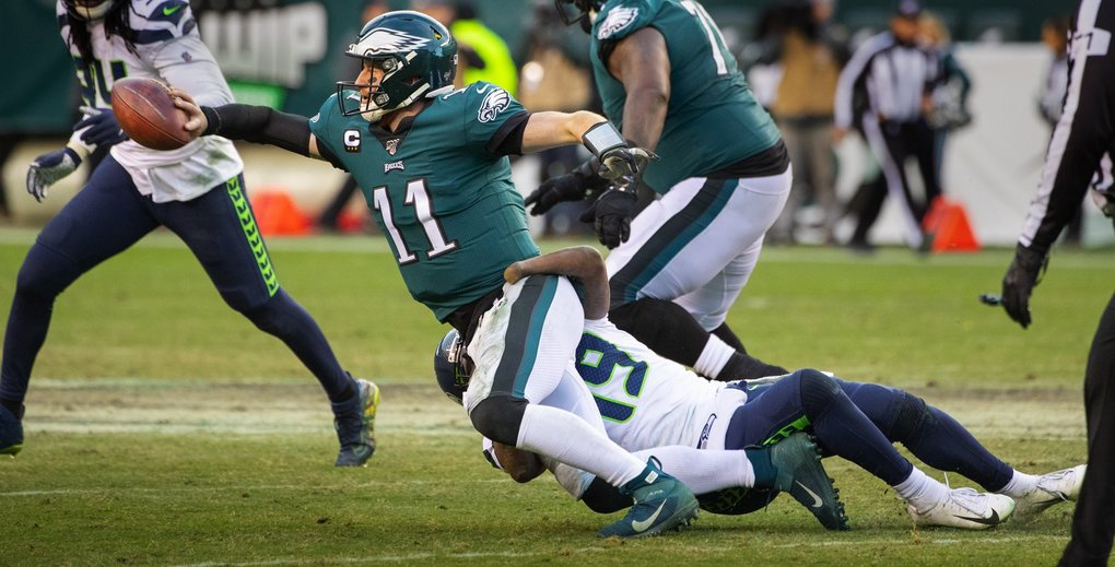 Seattle Seahawks outside linebacker Shaquem Griffin (49) grabs Philadelphia Eagles quarterback Carson Wentz (11) forcing an incompletion during 4th quarter action Sunday in Philadelphia. (Mike Siegel / The Seattle Times)