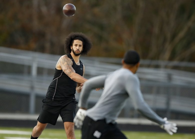 Colin Kaepernick participates in a workout for NFL football scouts and media Saturday in Riverdale, Ga. (Todd Kirkland / The Associated Press)