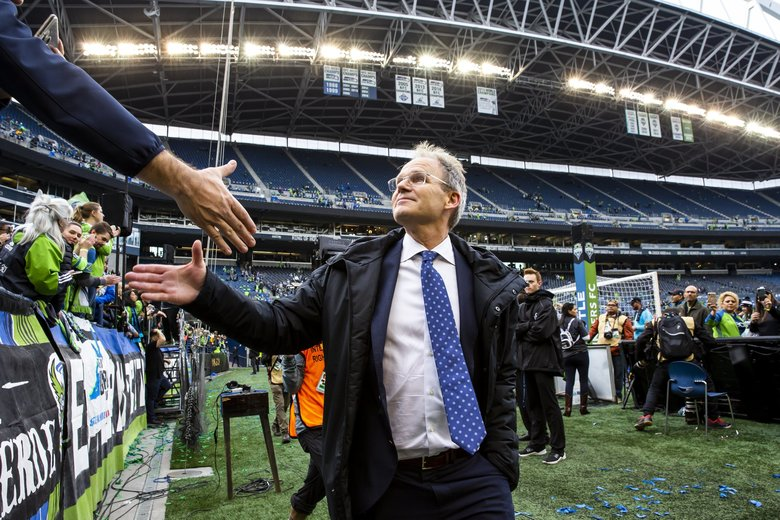 Sounders head coach Brian Schmetzer shakes hands with fans after the Seattle Sounders FC defeated Toronto FC 3-1 to win the MLS Cup Final at CenturyLink Field in Seattle Sunday November 10, 2019.  212052 (Dean Rutz / The Seattle Times)