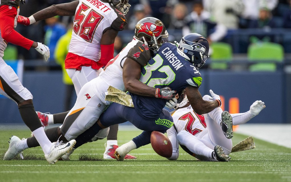 On 1st and 10 with under 12 minutes to play in the 4th, Seattle running back Chris Carson fumbles the ball away:  one of two fumbles he had on the day as the Seattle Seahawks take on the Tampa Bay Buccaneers at CenturyLink Field in Seattle Sunday November 3, 2019.  (Dean Rutz / The Seattle Times)