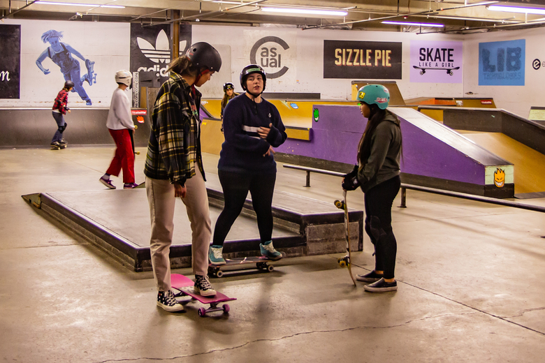Connor McConnaughey (center) guides beginners as they tackle skateboarding basics. (Christy Karras / Special to The Seattle Times)