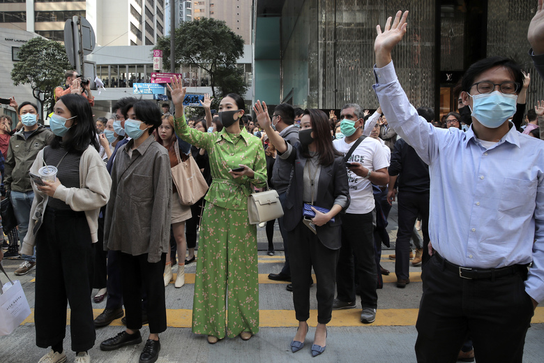 Protesters hold up their hands to symbolize pro-democracy demonstrators' five demands during a demonstration in the financial district in Hong Kong, Wednesday, Nov. 20, 2019. (AP Photo / Kin Cheung)