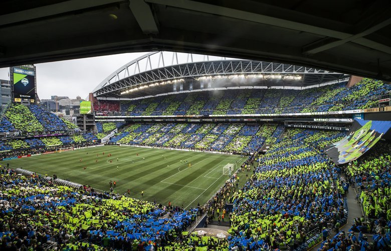 Fans color the stands in blue and green before the Seattle Sounders FC take on Toronto FC for the MLS Cup Final at CenturyLink Field in Seattle Sunday November 10, 2019.  212068
