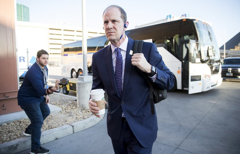 Head coach Mike Hopkins walks in off the bus with his Starbucks in hand before the Washington Huskies take on the Oregon Ducks for the final game of the Pac-12 Tournament at T-Mobile Arena in Las Vegas, Nevada Saturday March 16, 2019. 209655