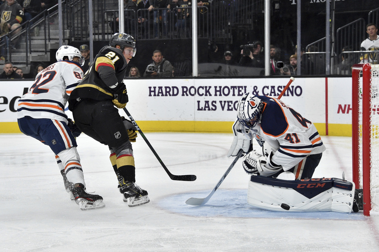 Vegas Golden Knights center Cody Eakin (21) shoots again Edmonton Oilers goaltender Mike Smith during the second period of an NHL hockey game Saturday, Nov. 23, 2019, in Las Vegas. (AP Photo/David Becker)