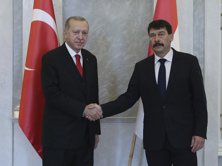 Hungarian President Janos Ader, right, and Turkish President Recep Tayyip Erdogan shake hands before a meeting, in Budapest, Hungary, Thursday, Nov. 7, 2019. Erdogan is on a one-day state visit to Hungary .( Presidential Press Service via AP, Pool )