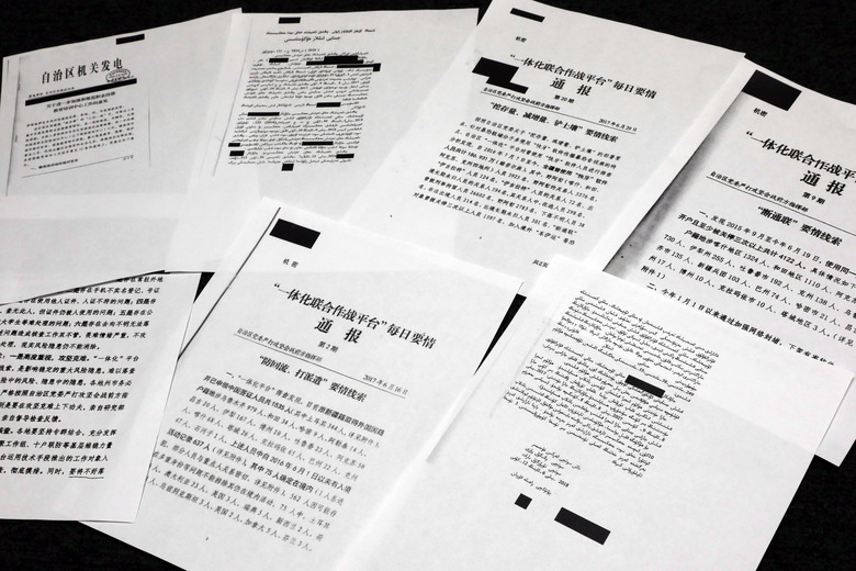 A sample of classified Chinese government documents leaked to a consortium of news organizations is displayed in New York, Friday, Nov. 22, 2019. Beijing has detained more than a million Uighurs, ethnic Kazakhs and other Muslim minorities for what it calls voluntary job training. The confidential documents lay out the Chinese government's deliberate strategy to lock up ethnic minorities to rewire their thoughts and even the language they speak. (AP Photo/Richard Drew)