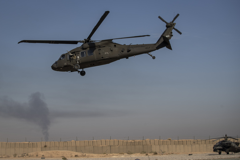 A helicopter takes off from a US military base at an undisclosed location in eastern Syria, Monday, Nov. 11, 2019. The deployment of the mechanized force comes after US troops withdrew from northeastern Syria, making way for a Turkish offensive that began last month. (AP Photo/Darko Bandic)
