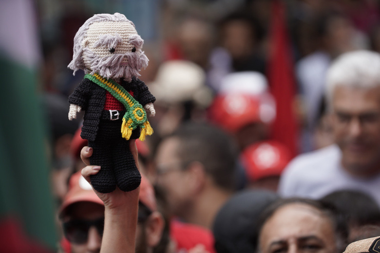 "A supporter holds up a crochet doll depicting former Brazilian President Luiz Inacio Lula da Silva during a rally at the Metal Workers Union headquarters, in Sao Bernardo do Campo, Brazil, Saturday, Nov. 9, 2019. Da Silva addressed thousands of jubilant supporters a day after being released from prison. ""During 580 days, I prepared myself spiritually, prepared myself to not have hatred, to not have thirst for revenge,"" the former president said. (AP Photo/Leo Correa)"