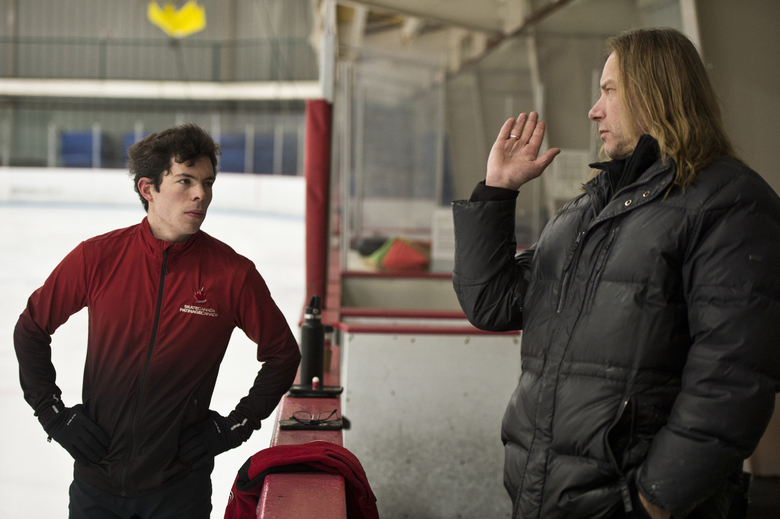 In this Oct. 30, 2019 photo, figure skater Keegan Messing talks with his coach, Ralph Berghart, at O'Malley Sports Center in Anchorage, Alaska. Messing has always skated with passion and showmanship. Whether he is channeling Charlie Chaplin, Gene Kelly or the Incredible Hulk, he is a storyteller capable of charming audiences from Fur Rendezvous to the Olympics.  (Marc Lester/Anchorage Daily News via AP)