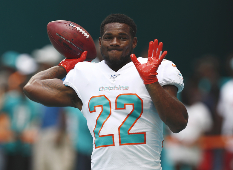 FILE – In this Sept. 8, 2019, file photo, Miami Dolphins running back Mark Walton (22) warms up before an NFL football game against the Baltimore Ravens, in Miami Gardens, Fla. The Dolphins have released troubled running back Mark Walton, saying he had been involved in an unspecified police matter. Tuesday's, Nov. 19, 2019,  announcement came as the second-year player served a four-game suspension for violating NFL conduct and substance abuse policies. (AP Photo/Brynn Anderson, File)