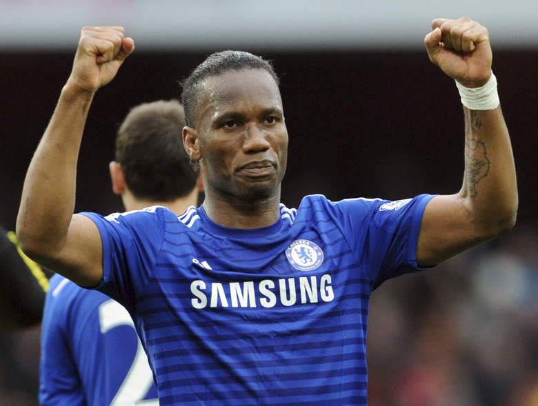FILE – In this Sunday, April 26, 2015 file photo, Chelsea's Didier Drogba during the English Premier League soccer match between Arsenal and Chelsea at the Emirates Stadium, London, England. The international soccer players now studying on an executive masters course could field one of the best school teams ever seen. After classes this week, Ballon d'Or winner Kaka was joined on the field by Champions League winners Florent Malouda and Julio Cesar and an array of one-time national team stars. Didier Drogba, though not playing, and Andriy Arshavin are also classmates for an 18-month education now in its third edition. (AP Photo/Rui Vieira, file)