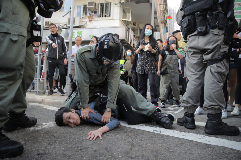 A protester is detained in Hong Kong Monday, Nov. 11, 2019. Hong Kong is in the sixth month of protests that began in June over a proposed extradition law and have expanded to include demands for greater democracy and other grievances. (AP Photo/Kin Cheung)