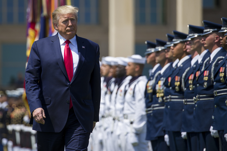 FILE – In this July 25, 2019, file photo, President Donald Trump reviews the troops during a full honors welcoming ceremony for Secretary of Defense Mark Esper at the Pentagon in Washington. If there was one day that crystallized all the forces that led to the impeachment investigation of President Donald Trump, it was July 25. That was the day of his phone call with Ukraine's new leader, pressing him for a political favor.  (AP Photo/Alex Brandon, File)