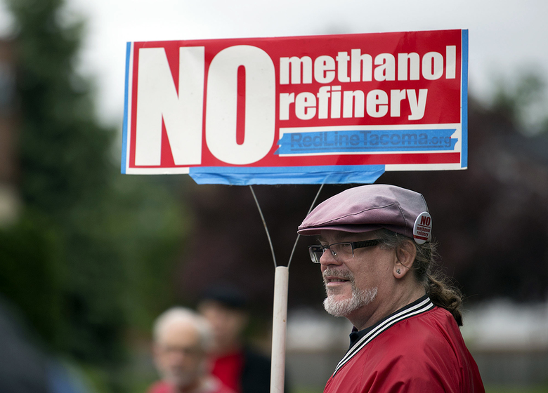 Mark Keely, of Kalama, Cowlitz County., stands in 2017 with other protesters outside the Washington Department of Ecology's Vancouver field office. He and others were demonstrating against the proposed methanol refinery that could be built in Kalama. The department dealt the project a setback on Friday, Nov. 22, 2019, saying it could not proceed without further environmental review of its greenhouse-gas emissions. (Amanda Cowan/The Columbian via AP, File)
