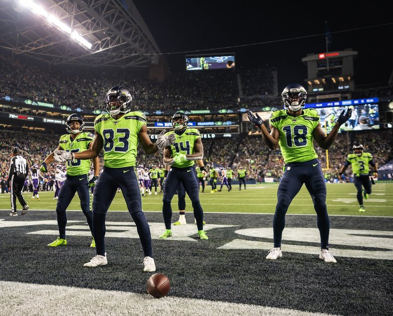 After David Moore's 60-yard touchdown reception, Seattle Seahawks receivers dance in the end zone during a game against the Minnesota Vikings on Monday, Dec. 2, 2019 at CenturyLink Field in Seattle. (Dean Rutz / The Seattle Times)