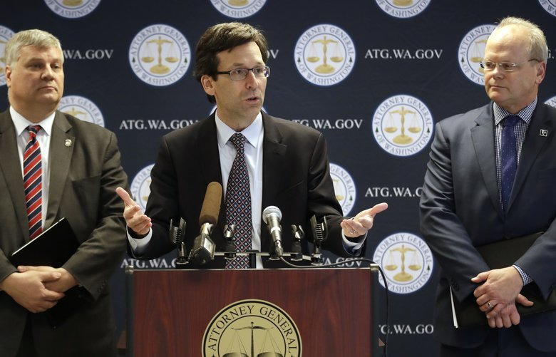 Washington state Attorney General Bob Ferguson, center, speaks as King County Prosecuting Attorney Dan Satterberg, left, and Thurston County Prosecuting Attorney Jon Tunheim look on during a news conference about Ferguson's lawsuit challenging a Trump Administration practice of ICE arrests at courthouses Tuesday, Dec. 17, 2019, in Seattle. Washington state has sued the Trump administration over its practice of arresting people at courthouses for immigration violations, saying it interferes with the state's authority to run its own judicial system. (AP Photo/Elaine Thompson) WAET103 WAET103