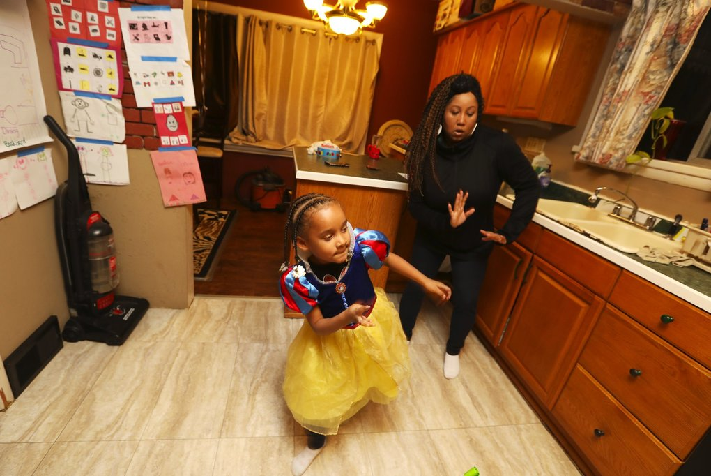 With music playing, Shauna Robinson dances with Terricca, who's come a long way from the girl who a couple years ago barely talked. (Ken Lambert / The Seattle Times)