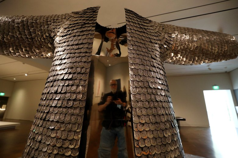 """Some / One,"" Do Ho Suh's 2001 sculpture, is installed in the Seattle Asian Art Museum's expansion this month. The sculpture by the contemporary South Korean artist contains tens of thousands of stainless-steel military-style dog tags and measures more than 24 feet in diameter. (Alan Berner / The Seattle Times)"
