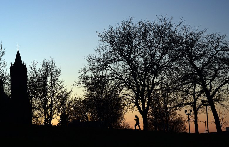 The sun sets behind the Syracuse University campus at dusk Thursday, Dec. 1, 2011, in Syracuse, N.Y.  Syracuse fired associate head basketball coach Bernie Fine in the wake of an investigation into child molestation allegations against him. (AP Photo/Heather Ainsworth) NYOTK