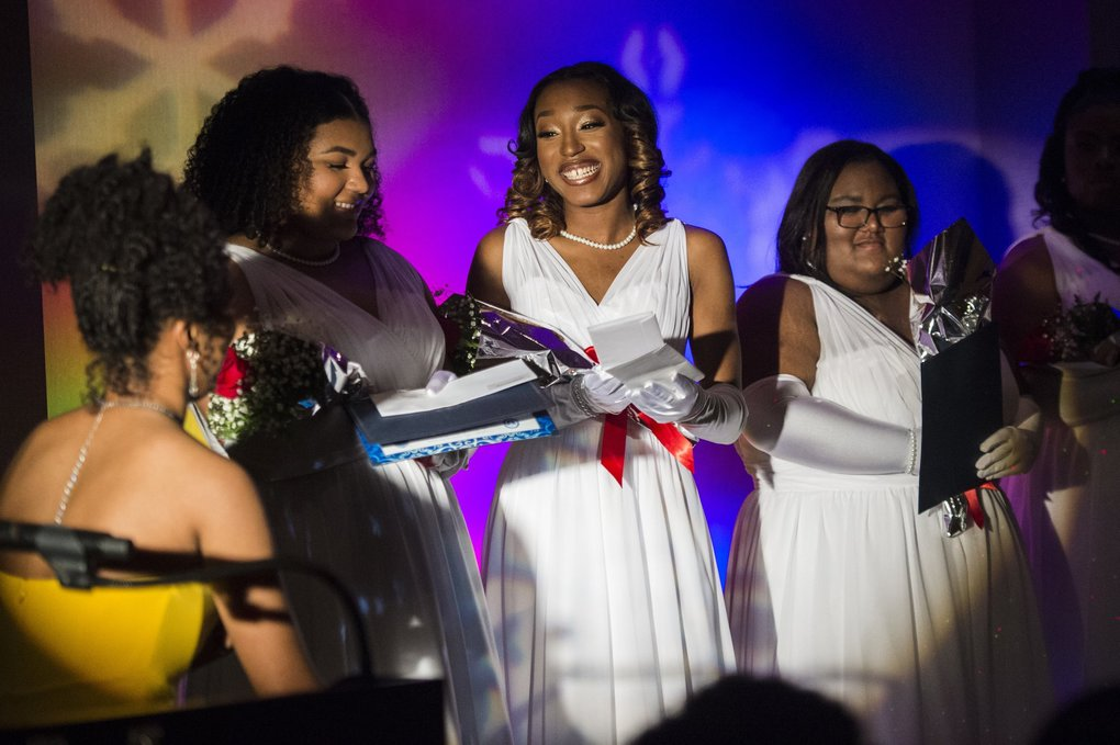 Debutante Janiya Donaldson accepts a scholarship during the WRC ball at the DoubleTree Suites at Southcenter.  (Amanda Snyder / The Seattle Times)