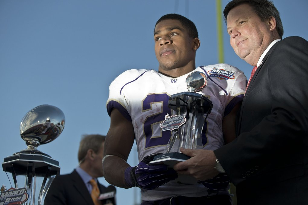 Washington's Bishop Sankey accepts the trophy for Most Valuable Player in the 2012 Las Vegas Bowl against Boise State. (Dean Rutz / The Seattle Times)