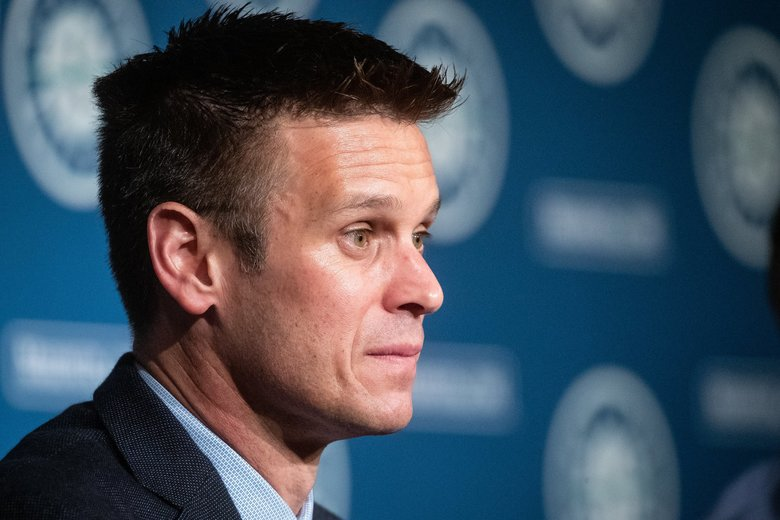 Mariners general manager Jerry Dipoto speaks during the press conference to announce signing first baseman Evan White at T-Mobile Park last month. (Andy Bao / The Seattle Times)