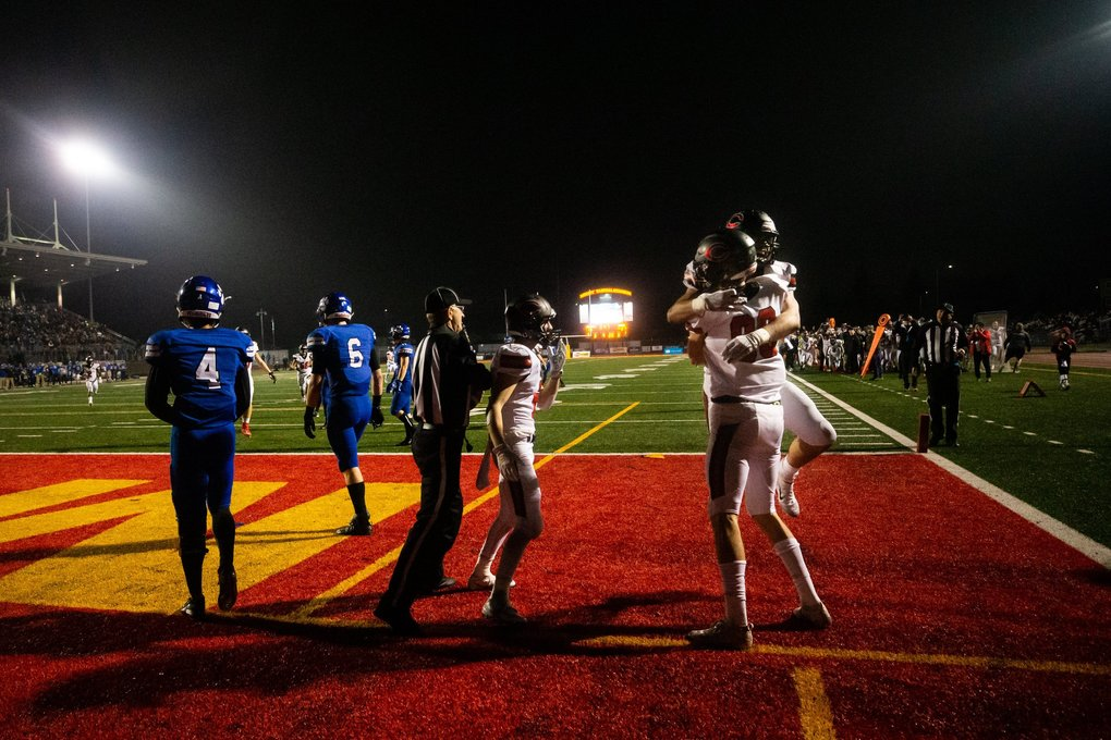 Papermakers Kenny Wright (87) and Jackson Clemmer (83) celebrate Clemmer's touchdown during the second half of the WIAA 4A state championship game between Bothell and Camas High School at Mt. Tahoma High School on Dec. 7, 2019. (Andy Bao / The Seattle Times)