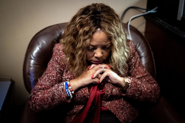 EDS.: SEVENTH IN A SERIES OF 36 PHOTOS DEPICTING BEHIND THE SCENES OF THE IMPEACHMENT PROCESS — Rep. Lucy McBath (D-Ga.) steals a private moment before the start of an impeachment hearing before the House Judiciary Committee in Washington on Monday morning, Dec. 9, 2019. Members of the House granted The New York Times rare access to photograph their impeachment preparations. (Erin Schaff/The New York Times)