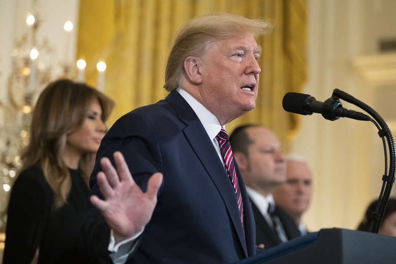 President Donald Trump, with first lady Melania Trump, speaks during a Hanukkah reception in the East Room of the White House Wednesday, Dec. 11, 2019, in Washington. (AP Photo/Manuel Balce Ceneta)