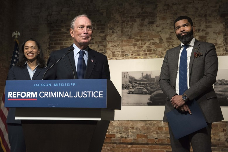 Democratic presidential candidate and former New York City Mayor Michael Bloomberg, center, speaks with members of the press following a roundtable on criminal justice reform led by Jackson, Mississippi Mayor Chokwe Lumumba, far right, at the Smith Robertson Museum in downtown Jackson on Tuesday, Dec. 3, 2019. (Sarah Warnock/The Clarion-Ledger via AP)