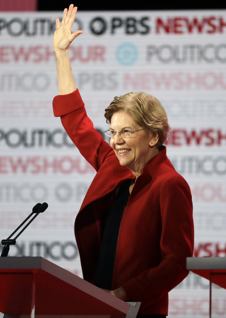 Sen. Elizabeth Warren, D-Mass., waves before a Democratic presidential primary debate Thursday, Dec. 19, 2019, in Los Angeles, Calif. (AP Photo/Chris Carlson)